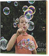 Boy With Colorful Bubbles Wood Print by Matthias Hauser