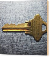 Brass Key On Stainless Steel. Wood Print by Ballyscanlon