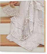 Bride Sitting On Stairs With Lace Fan Wood Print