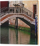 Bridge And Striped Poles Over A Canal In Venice Wood Print