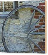 Broken Wagon Wheel Against The Wall Wood Print