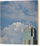 Building With Its Head In The Clouds Wood Print
