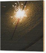 Burning Sparkler On Sidewalk At Night Wood Print
