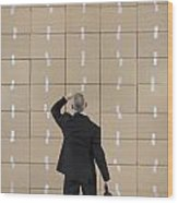 Businessman Facing A Cardboard Boxes Wall Wood Print by Sami Sarkis