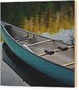 Canoe And Reflections On A Still Lake Wood Print