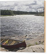 Canoe Pulled Up On The Shore Wood Print