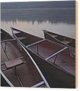 Canoes On Still Water Wood Print