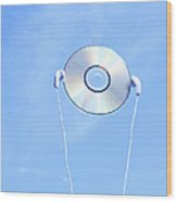 Cd With Earphone In The Sky. Wood Print