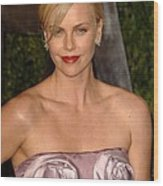 Charlize Theron Wearing A Dior Haute Wood Print by Everett