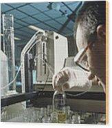 Chemist Analysing Fluids For Pesticide Pollutants Wood Print