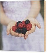 Child Holding Berries Wood Print