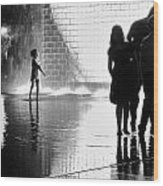 Child  Playing In Water Fountain Wood Print