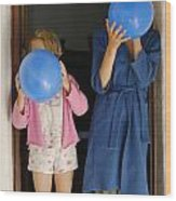 Children Blowing Up Balloons Wood Print