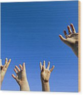 Childrens Hands Reach Toward The Blue Wood Print