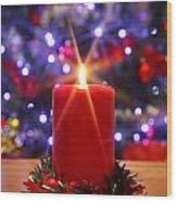 Christmas Candle With Starburst And Decorated Tree Background. Wood Print