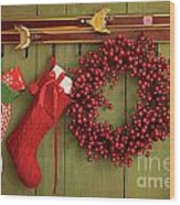 Christmas Stockings And Wreath Hanging On  Wall Wood Print