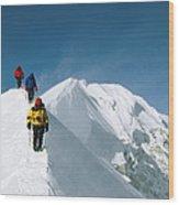 Climbers Hike Along A Ridge Wood Print