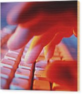 Close-up Of A Person Typing On A Computer Keyboard Wood Print