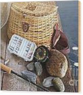 Close-up Of Fishing Equipment And Hat  Wood Print