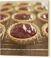 Close Up Of Jam Tarts Cooling On Wire Rack Wood Print