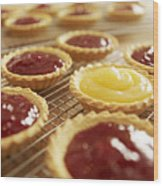 Close Up Of Jam Tarts Cooling On Wire Racks Wood Print