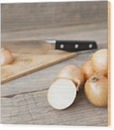 Close Up Of Onions And Knife On Table Wood Print
