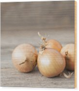Close Up Of Onions On Table Wood Print
