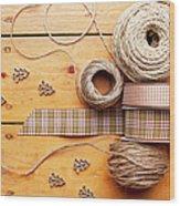 Close Up Of Ribbon, String And Shapes Wood Print