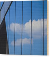 Clouds Reflected In A Glass Facade Wood Print