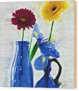 Cobalt Blue Glass Bottles And Gerbera Daisies Wood Print