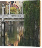 Cobblers Bridge And Morning Reflections In Ljubljana Wood Print by Greg Matchick