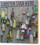 Colorful Lobster Buoys Hang On A New Wood Print by Stephen St. John