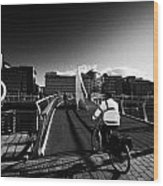 Commuter Cycling Over The Tradeston Bridge Pedestrian Bridge Over The River Clyde To The Financial D Wood Print