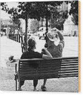 Couple Resting On A Downtown Bench On A Windy Day Wood Print