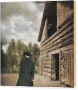 Cowboy Walking By Barn Wood Print
