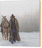 Cowboy Walking His Horse And Holding A Shotgun Wood Print by Thomas Kokta