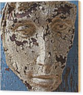 Cracked Face On Blue Wall Wood Print