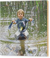Cute Tiny Boy Riding A Duck Wood Print