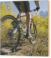Cyclist Rides Mountain Bike Among Trees Wood Print