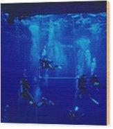Divers Decompressing Beneath A Boat Wood Print