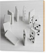 Dominoes In A Circle Beginning To Fall Over In A Chain Reaction Wood Print by Larry Washburn