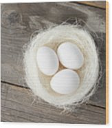 Eggs In Nest On Wooden Counter Wood Print