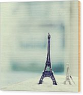 Eiffel Tower Still Life With Blurry Blue Backgroun Wood Print