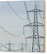 Electricity Pylons Against A Clear Blue Wood Print by Iain  Sarjeant