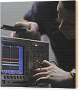 Electronics Technician Troubleshoots An Wood Print
