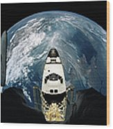 Elevated View Of A Spacecraft Orbiting Over The Earth Wood Print by Stockbyte