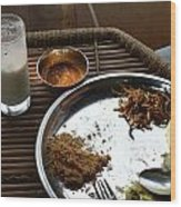 Enjoying A Plate Of Rajasthani Food On A Steel Plate On A Bamboo Table Wood Print