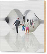 Family In Front Of Spoon Distoring Mirrors II Wood Print