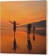 Family Running In The Beach At Sunset Wood Print