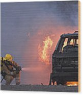 Firefighters Hosing A Burning Car Wood Print by Duncan Shaw